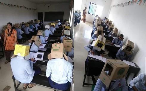 Tức giận khi giáo viên bắt học sinh đội thùng carton lên đầu để chống gian lận